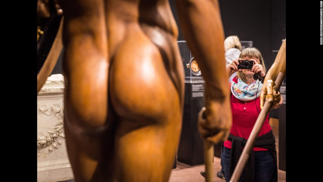 A visitor photographs a statue at an exhibition in Frankfurt, Germany, on Tuesday, May 3.