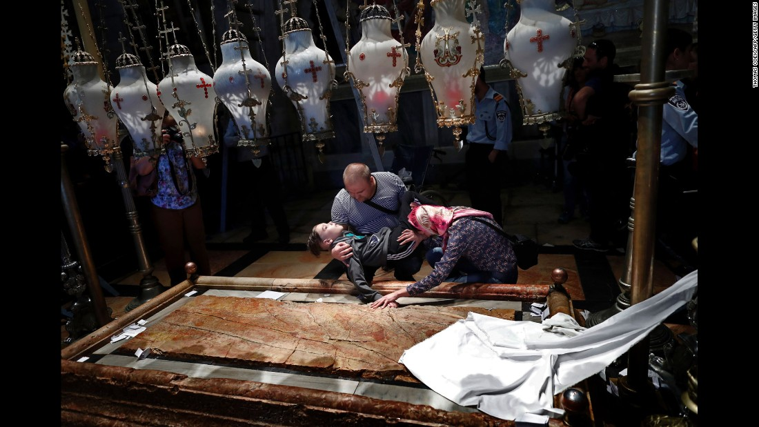 Orthodox Christian pilgrims pray with their disabled son inside Jerusalem's Church of the Holy Sepulchre on Friday, April 29. It was Good Friday on the Orthodox calendar.