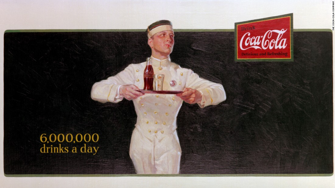 "<strong>1925:</strong> Coca-Cola's first billboard, ""Ritz Boy,"" promotes how popular the drink had become."