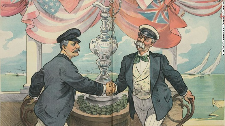 Illustration shows an American yachtsman shaking hands with Sir Thomas Lipton, with the America's Cup between them.