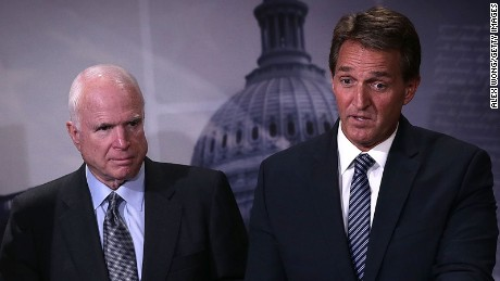 Sen. John McCain (R-AZ) and Sen. Jeff Flake (R-AZ) speak to members of the media during a news conference November 4, 2015 on Capitol Hill in Washington, DC.