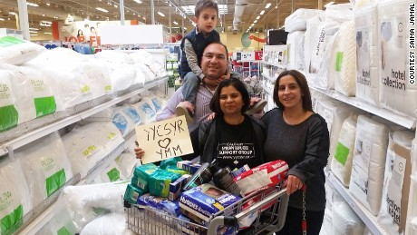 Members of the Syrian Refugee Support Group in Calgary, Alberta, are buying supplies for wildfire evacuees.