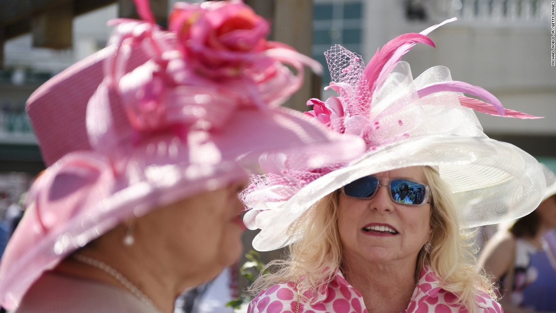 Advice from the Kentucky Derby: If your hat is having a pattern party, keep the dress design simple.