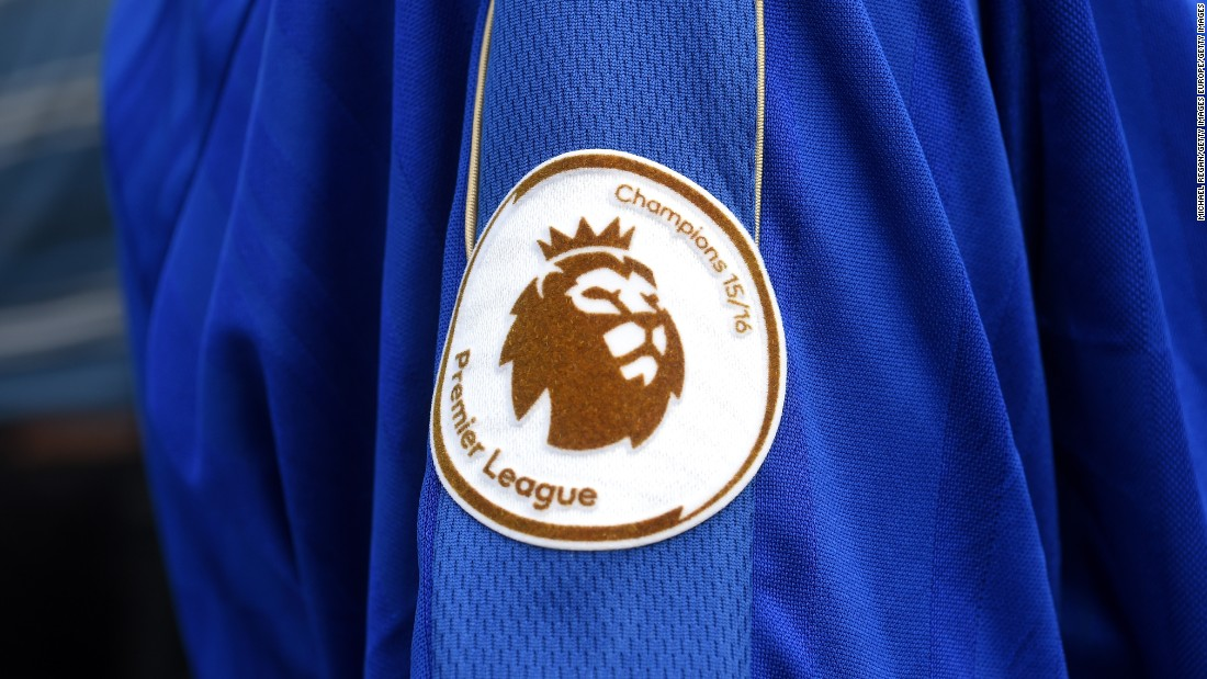 A newly minted Premier League Champions badge adorns a Leicester fan's shirt.