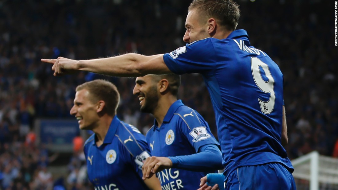 Leicester players celebrate Vardy's early goal.