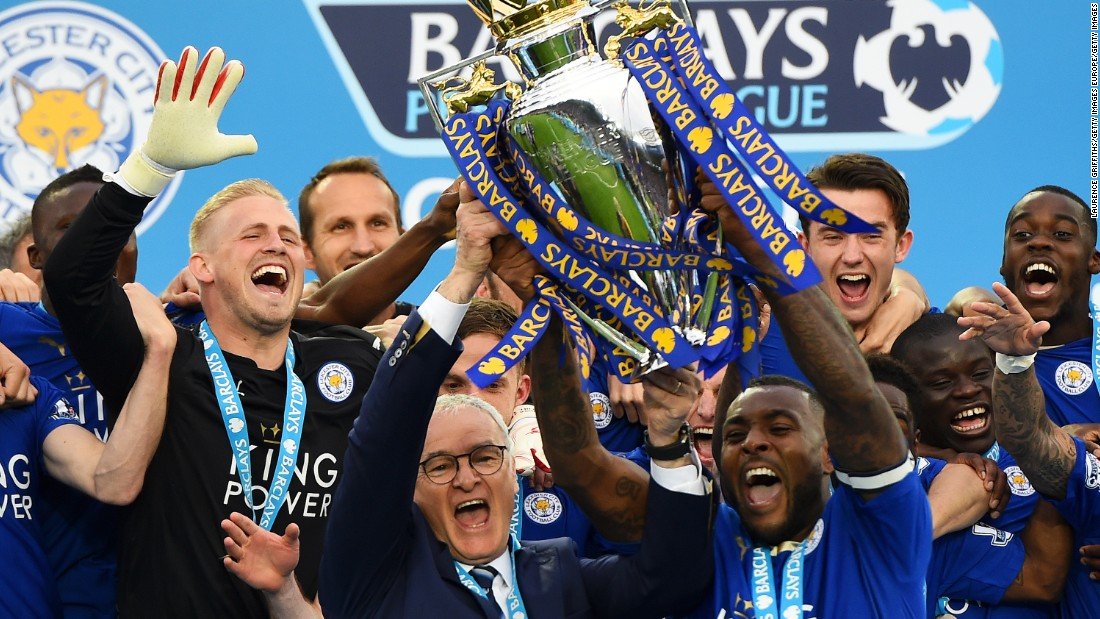 Captain Wes Morgan and manager Claudio Ranieri of Leicester City lift the Premier League trophy after defeating Everton 3-1.