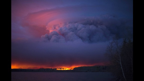 Smoke and flames create a dramatic sunset near Fort McMurray on Friday, May 6.