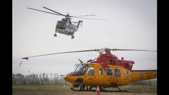 A helicopter helping with the Fort McMurray wildfire takes off from a staging base near Conklin, Alberta, on May 7.