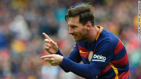 Barcelona's Argentinian forward Lionel Messi celebrates after scoring a goal during the Spanish league football match FC Barcelona vs RCD Espanyol at the Camp Nou stadium in Barcelona on May 8, 2016. / AFP / LLUIS GENE        (Photo credit should read LLUIS GENE/AFP/Getty Images)