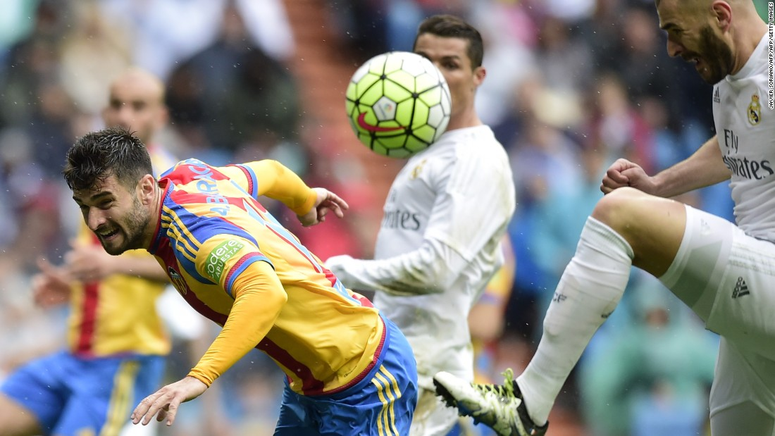 Karim Benzema (right) also found the target for Real against Valencia.