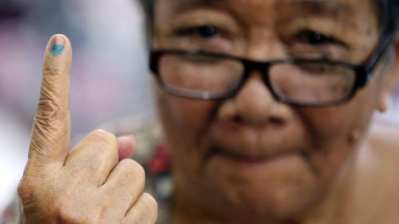 Esteban shows the indelible ink on her finger after casting her vote.
