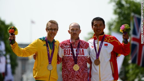 Jared Tallent (L) and Sergey Kirdyapkin (C) on the podium after the London 2012 Olympic Men's 50km race walk.