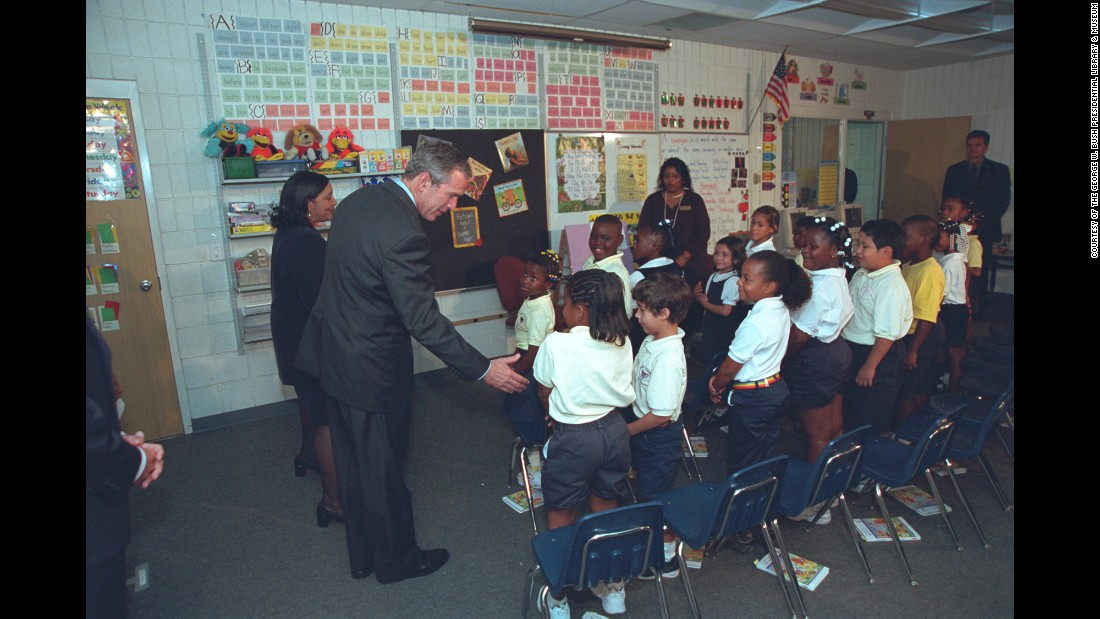 U.S. President George W. Bush greets students as he visits an elementary school in Sarasota, Florida, on September 11, 2001. It was here where Bush first learned of the terrorist attacks against the United States. These photos, taken by former White House photographer Eric Draper, were recently released by the George W. Bush Presidential Library and Museum.