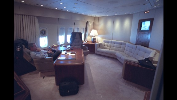 Bush watches news coverage of the attacks aboard Air Force One.