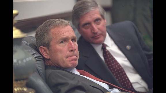 Bush and White House Chief of Staff Andrew Card talk privately after arriving at Barksdale Air Force Base.
