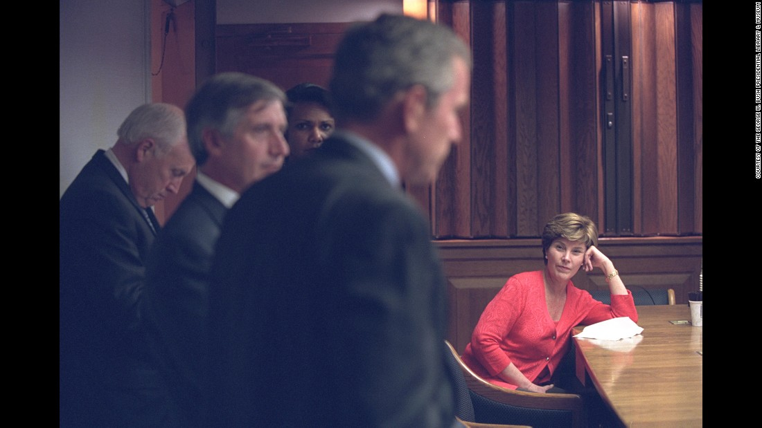 First lady Laura Bush listens as Bush discusses the terrorist attacks with White House staff in the President's Emergency Operations Center.