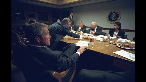 Bush meets with his staff after delivering his address. Want to see more? Rare photos offer look inside Osama bin Laden's Afghan hideout.