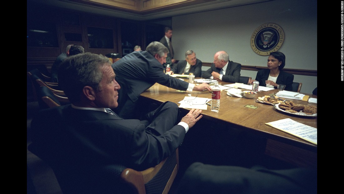 "Bush meets with his staff after delivering his address. Want to see more? <a href=""http://www.cnn.com/2015/03/11/world/gallery/osama-bin-laden-rare-photos/index.html"">Rare photos</a> offer look inside Osama bin Laden's Afghan hideout."