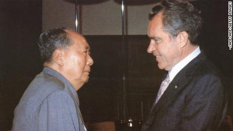 Chinese communist leader Chairman Mao Zedong welcomes US President Richard Nixon at his house in Beijing during Nixon's historic trip to China in 1972.