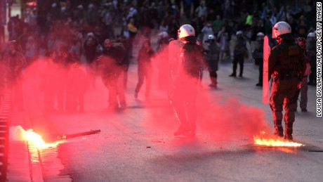 Police face protesters throwing flares and molotov coctails during a protest rally outside the Greek parliament building Athens,  May 8, 2016.