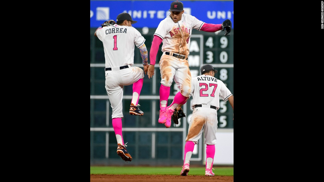 Houston's Carlos Correa and George Springer celebrate a home win over Seattle on Sunday, May 8. The team was wearing pink in honor of Mother's Day and breast cancer awareness.