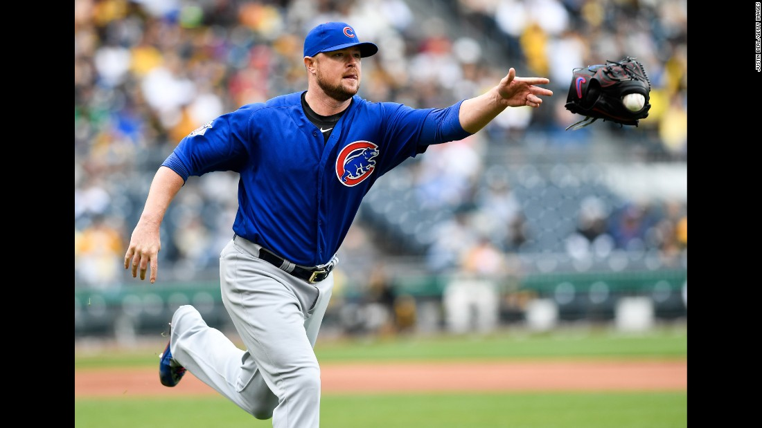 Chicago Cubs pitcher Jon Lester tosses his glove to first base -- with the ball stuck in it -- after fielding a ball in Pittsburgh on Wednesday, May 4.