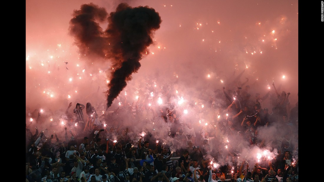 Fans of the Brazilian soccer club Corinthians light flares Wednesday, May 4, before a Copa Libertadores match in Sao Paulo, Brazil.