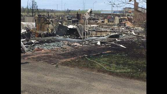 CNN's Dan Simon went on a tour of the area hit by the massive fire in Fort McMurray.