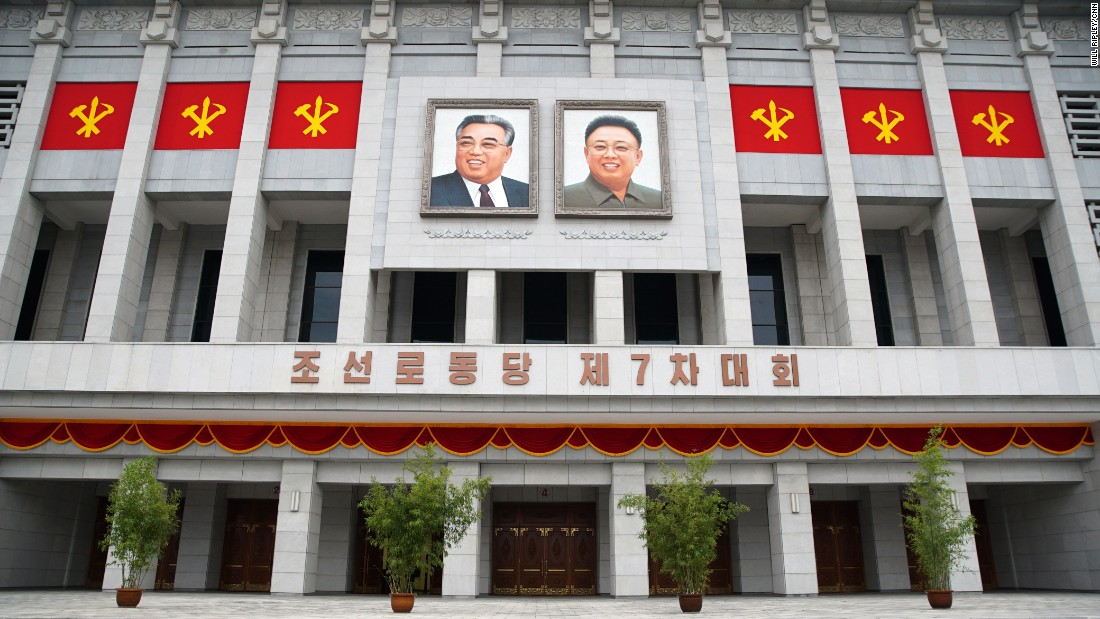 The images of former North Korean leaders Kim Il Sung (left) and Kim Jong Il hang outside the April 25 House of Culture as Pyongyang holds its 7th Congress of Workers' Party.