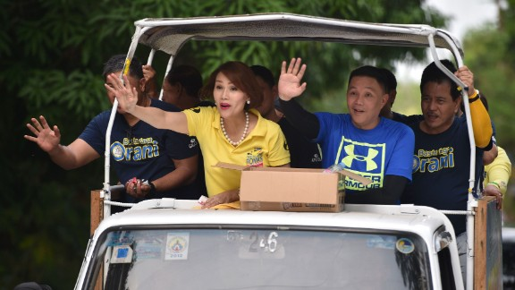 Geraldine Roman waves to supporters while campaigning in Bataan province, April 30, 2016.