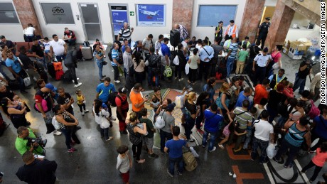 Cubans wait Tuesday at Panama City's airport for flights to northern Mexico.
