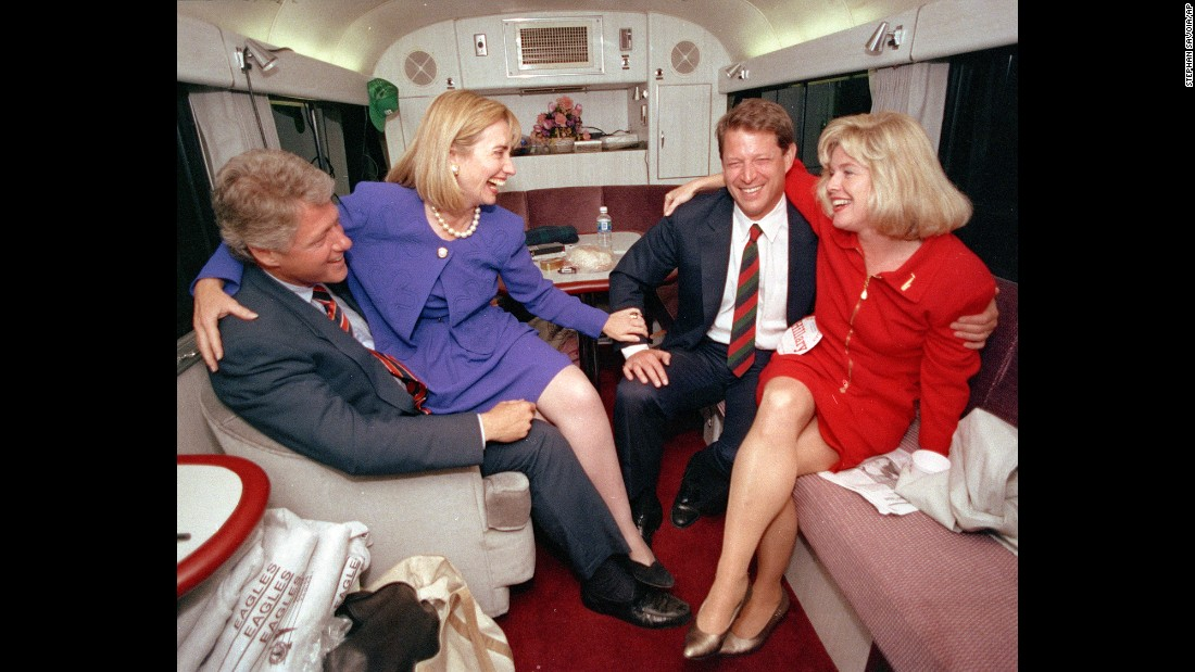During the 1992 presidential campaign, Clinton jokes with her husband's running mate, Al Gore, and Gore's wife, Tipper, aboard a campaign bus.