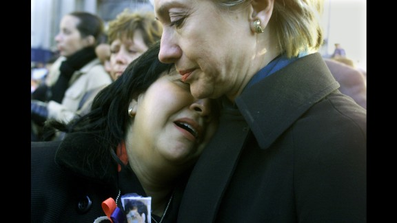 Sen. Clinton comforts Maren Sarkarat, a woman who lost her husband in the September 11 terrorist attacks, during a ground-zero memorial in October 2001.