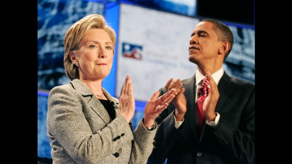 Clinton and another presidential hopeful, U.S. Sen. Barack Obama, applaud at the start of a Democratic debate in 2007.