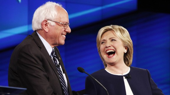 "U.S. Sen. Bernie Sanders shares a lighthearted moment with Clinton during a Democratic presidential debate in October 2015. It came after Sanders gave his take on the Clinton email scandal. ""The American people are sick and tired of hearing about the damn emails,"" Sanders said. ""Enough of the emails. Let"