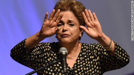 Brazilian President Dilma Rousseff gestures  during the opening ceremony of the 4th National Policy Conference on Women in Brasilia on May 10, 2016. Brazilian President Dilma Rousseff launched a last-minute bid Tuesday to block impeachment proceedings against her in what could be her final hours in power. / AFP / EVARISTO SA        (Photo credit should read EVARISTO SA/AFP/Getty Images)