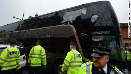 The bus carrying the Manchester United team is escorted by police after having a window smashed on its way to West Ham's Boleyn ground