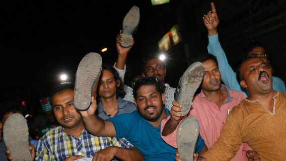 Bangladeshis show shoes as they celebrate in Dhaka.