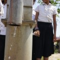 children pump water in cambodia