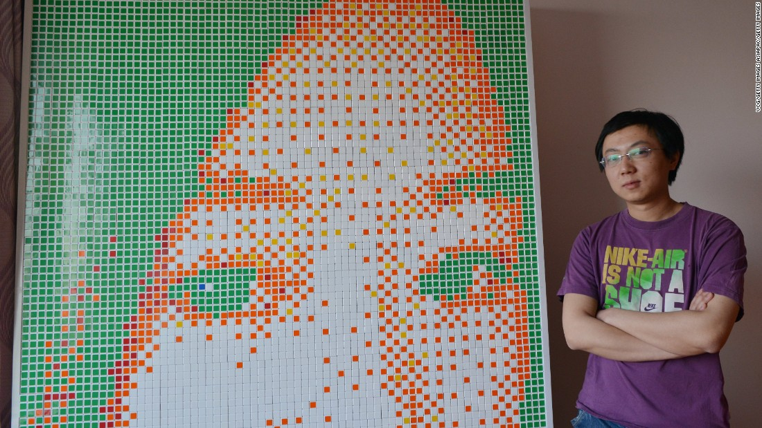 Tong Aonan spent 20 hours building the portrait of out of Rubik's cubes.