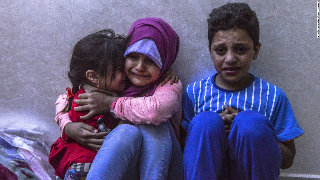 Children cry after a rocket struck close to their home in Kilis, Turkey, on Saturday, May 7. Kilis is near the Syrian border and has been regularly targeted by jihadists this year, according to the Dogan News Agency.