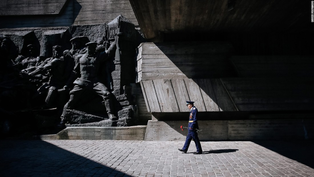 "A World War II veteran carries flowers as he walks past a monument at the World War II museum in Kiev, Ukraine, on Monday, May 9. V-E Day -- the day Germany surrendered, ending the war in Europe -- was May 8, 1945. <a href=""http://www.cnn.com/2016/05/12/world/gallery/tbt-europe-after-world-war-ii/index.html"" target=""_blank"">#tbt: Unseen photos of Europe after the war</a>"