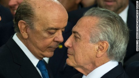 "Brazilian acting president Michel Temer (R) speaks with the new Foreign Minister Jose Serra, during the new ministers' inauguration ceremony at Planalto palace in Brasilia, on May 12, 2016.  Temer said Thursday his new cabinet must work to restore the country's ""credibility,"" in his first address after assuming power from suspended predecessor Dilma Rousseff pending her impeachment trial. / AFP / ANDRESSA ANHOLETE        (Photo credit should read ANDRESSA ANHOLETE/AFP/Getty Images)"