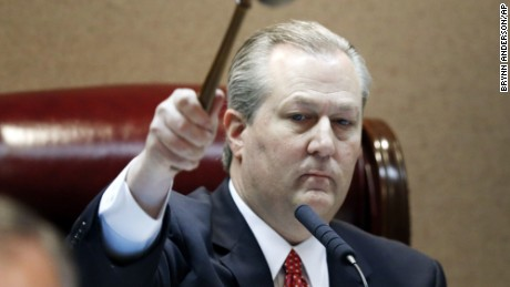 FILE - In this Feb. 2, 2016 file photo, Rep. Mike Hubbard of Auburn, Ala., pounds the gavel to signify the beginning of Alabama legislation's opening,  in Montgomery, Ala.  Hubbard awaits a trial on 23 felony ethics charges that could result in his removal.