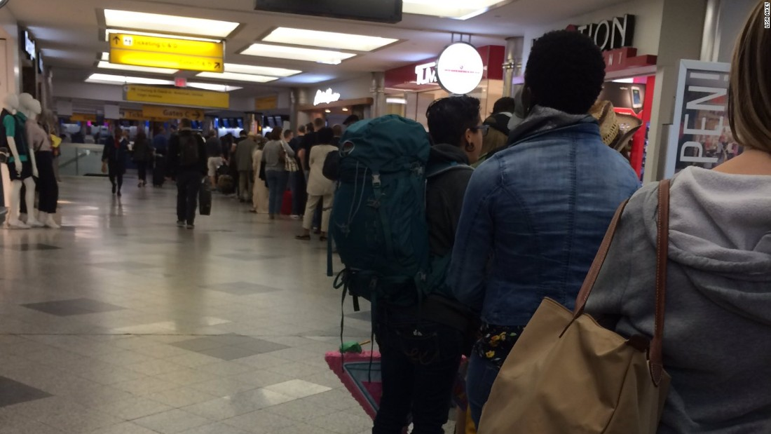 Lisa Akey said she waited in line for 35 minutes Friday morning at LaGuardia Airport. She said the Transportation Safety Administration let people who had earlier flights go through lines faster.