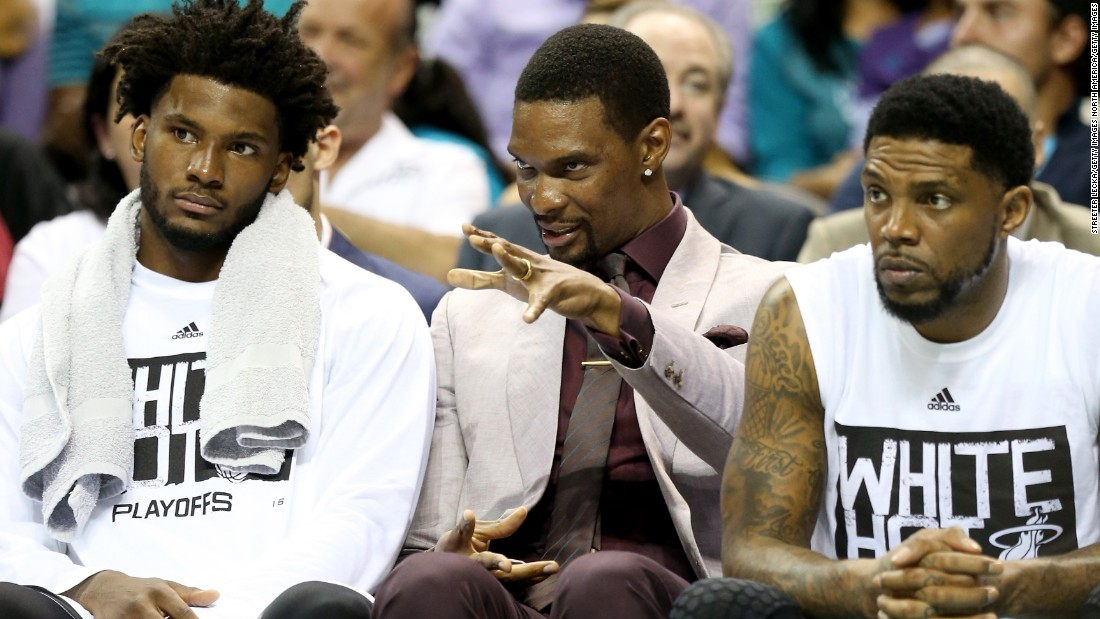 Winslow (left), is currently a bench player but has logged heavy minutes in the Heat's playoff run. He is pictured sitting with injured Heat star Chris Bosh (center) and veteran Udonis Haslem.