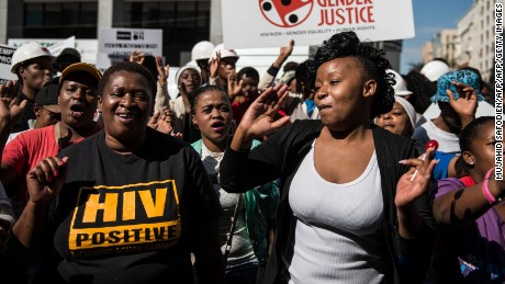 Supporters of miners gather outside court in Johannesburg.