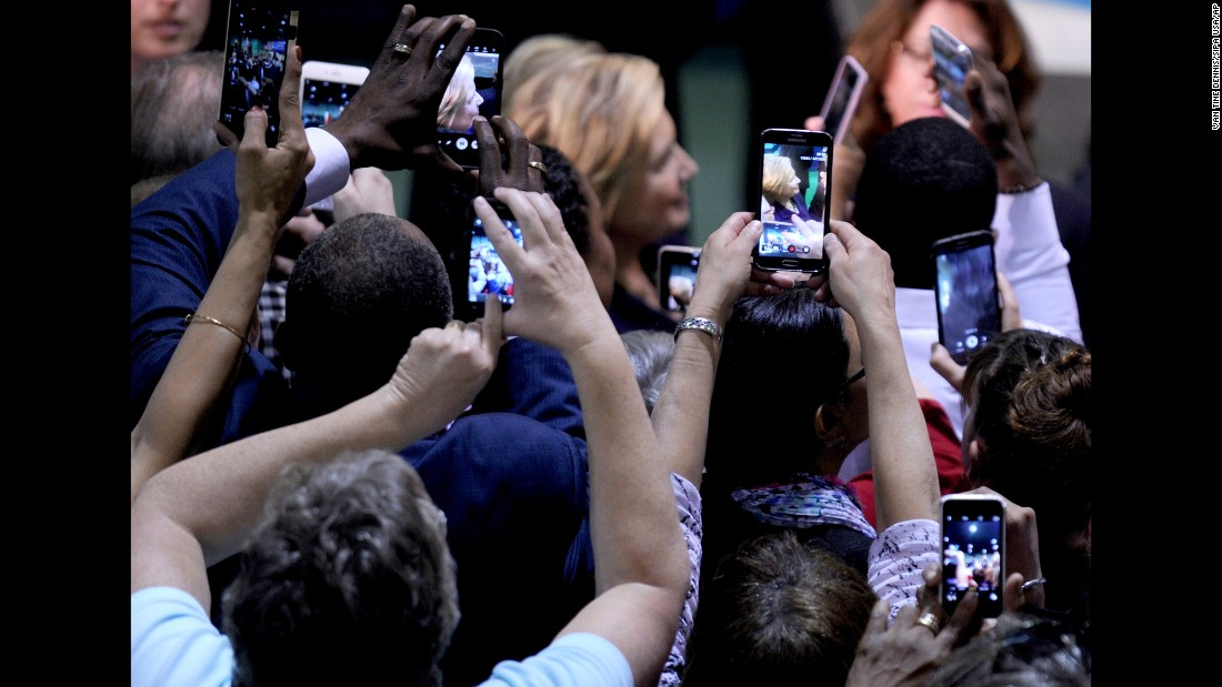 People take photos of Democratic presidential candidate Hillary Clinton during a campaign event in Blackwood, New Jersey, on Wednesday, May 11.