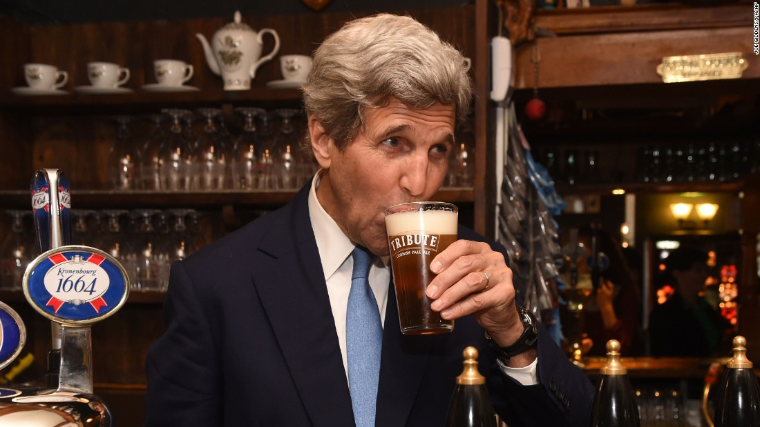 U.S. Secretary of State John Kerry sips a pint of beer while visiting Oxford, England, on Wednesday, May 11.