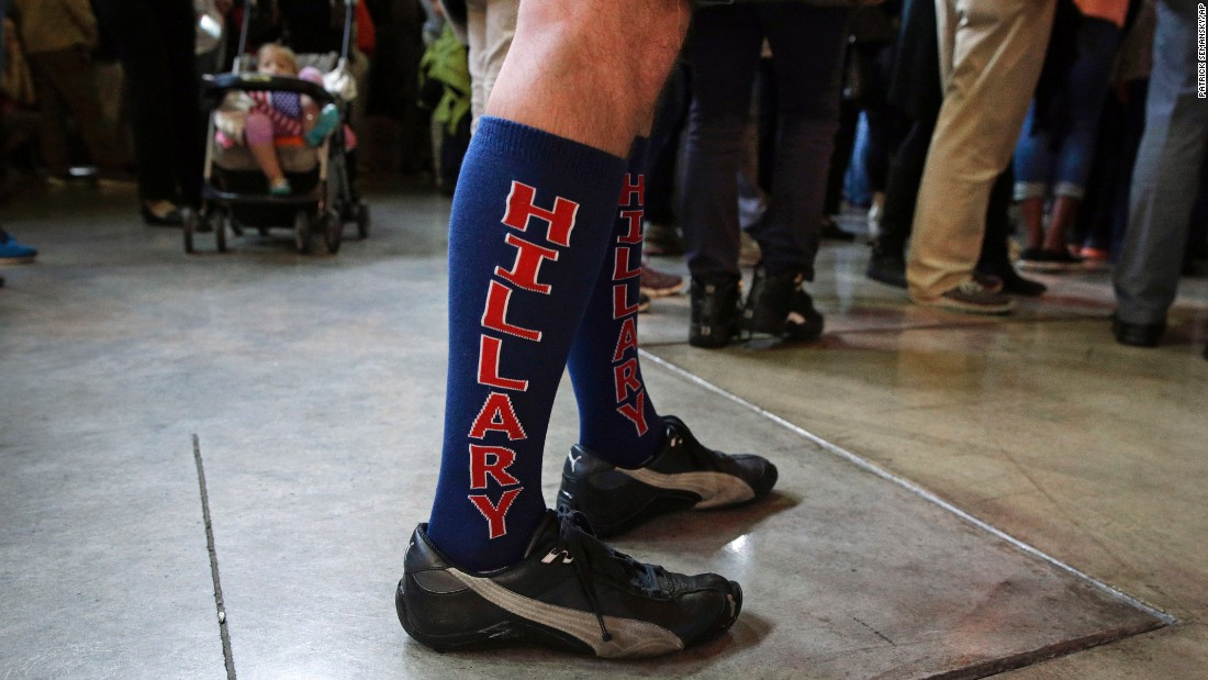 A man wears socks in support of Hillary Clinton as he listens to the presidential candidate speak in Louisville, Kentucky, on Tuesday, May 10.